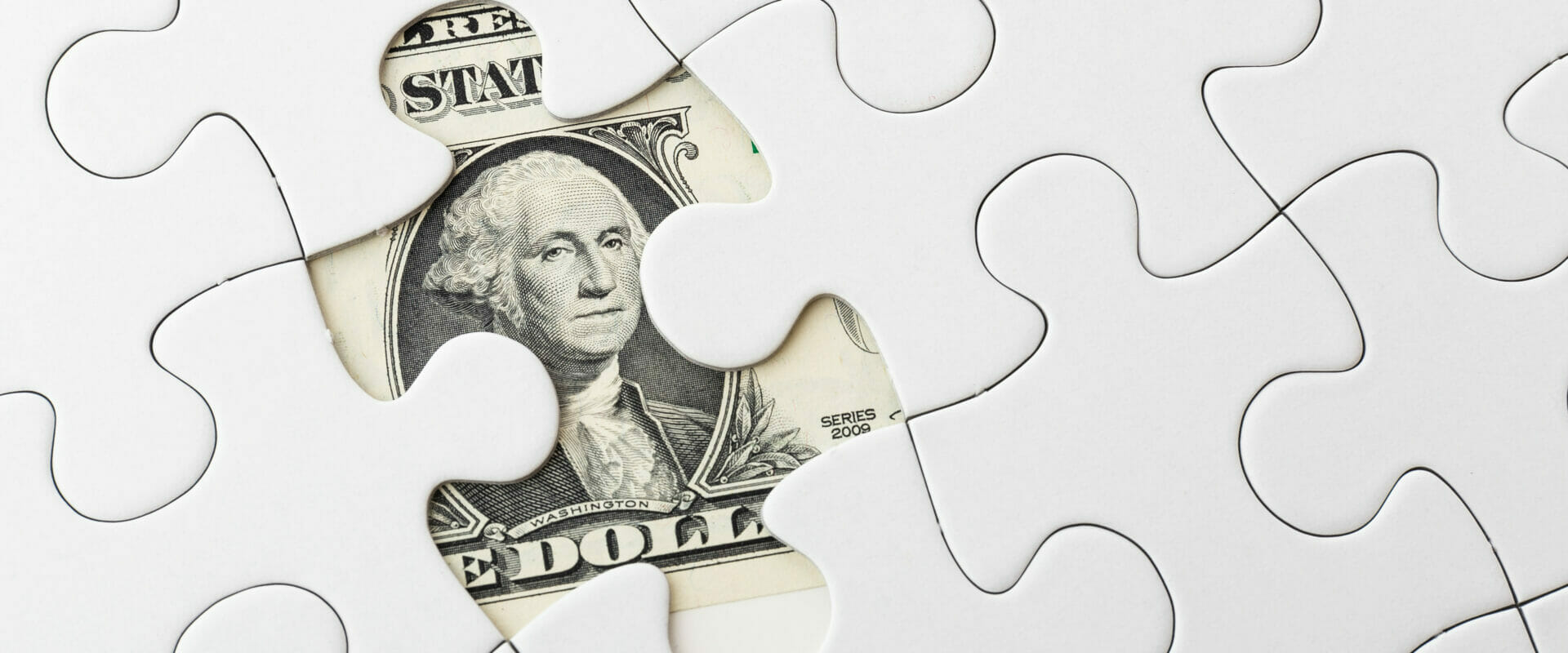 a puzzle with a misisng piece revealing a dollar as a symbol of business impact analysis