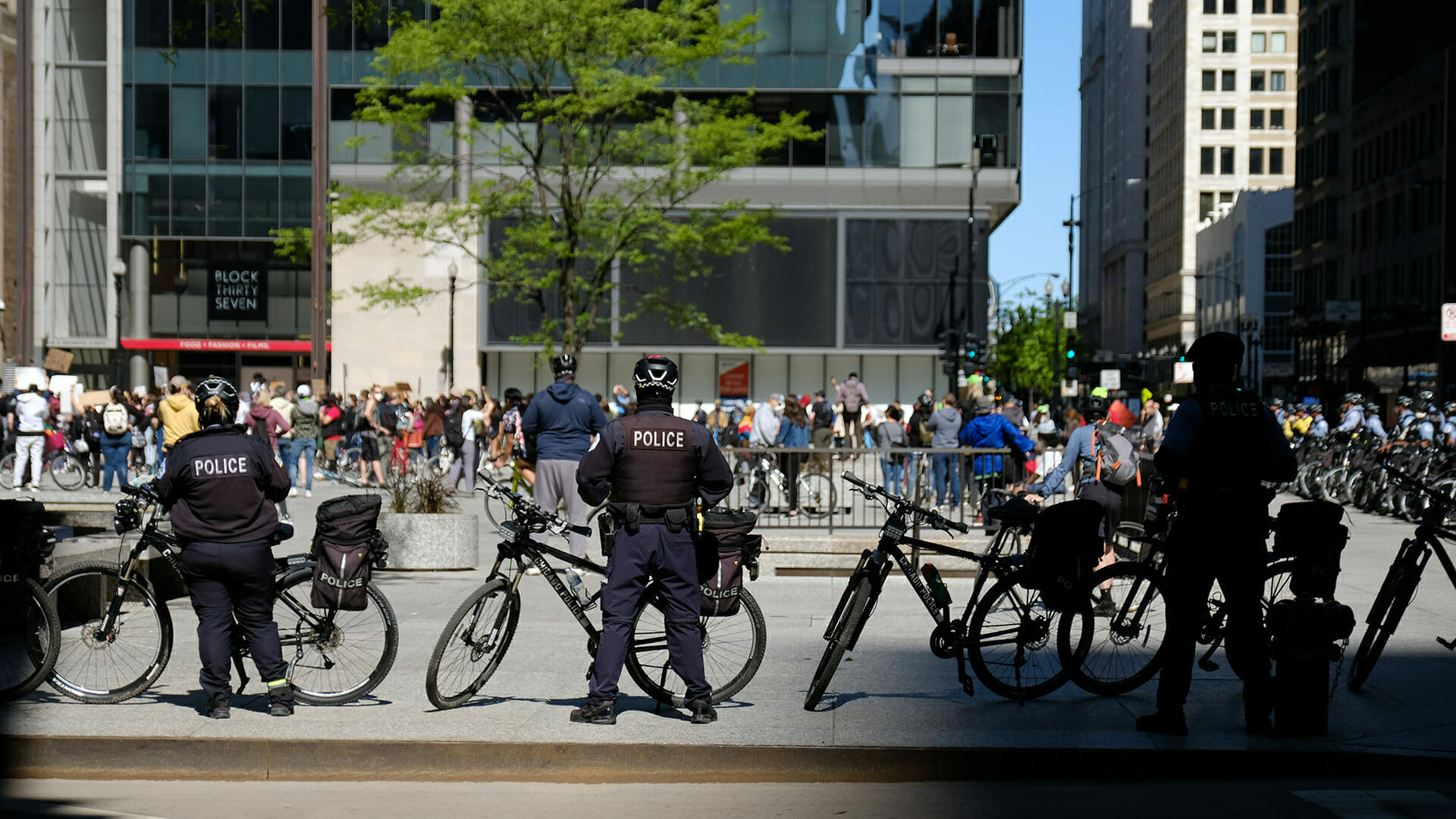 police prepare for election day civil unrest as a political protest moves through a downtown area during a moment of civil unres