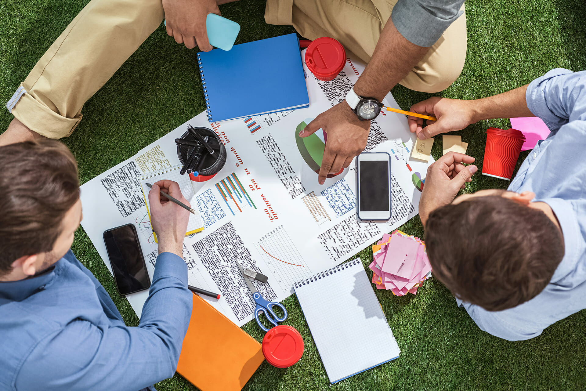 overhead view of business people working on a crisis management plan outside